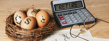 "Calculator reading ""Retire"" and nest with eggs labelled with dollar signs"