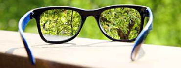View through pair of glasses sitting on surface