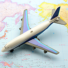 Model airplane on world map