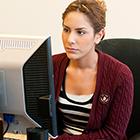 Young female using desktop computer